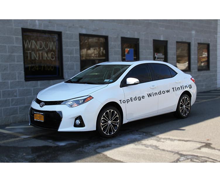 White Toyota Corolla with 40% tint